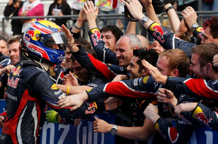 Red Bull Formula One driver Mark Webber of Australia, left, celebrates with his team crew after coming in 3rd, having started 18th on the grid at the Chinese Formula One Grand Prix in Shanghai, China. (AP Photo)