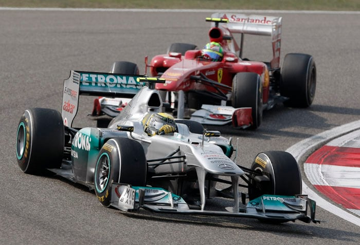 Mercedes driver Nico Rosberg of Germany leads Ferrari driver Felipe Massa of Brazil during the Chinese Formula One Grand Prix at the Shanghai International Circuit in Shanghai, China. (AP Photo)