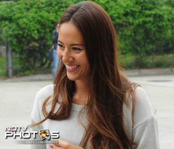 Jenson Button's girlfriend Jessica Michibata had a lot to smile about as the McLaren driver worked his way up to finish behind Rosberg to find himself a place on the podium again.