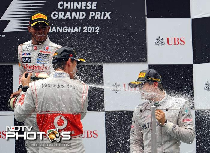 Lewis Hamilton (l) was the other man on the podium making it a 2 and 3 for McLaren's. Sebastian Vettel and Mark Webber finished 4th and 5th respectively for the Red Bulls.