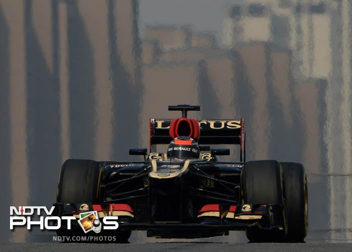 Lotus driver Kimi Raikkonen will share the front row with Mercedes' Lewis Hamilton in Sunday's race at Shanghai International Circuit.
