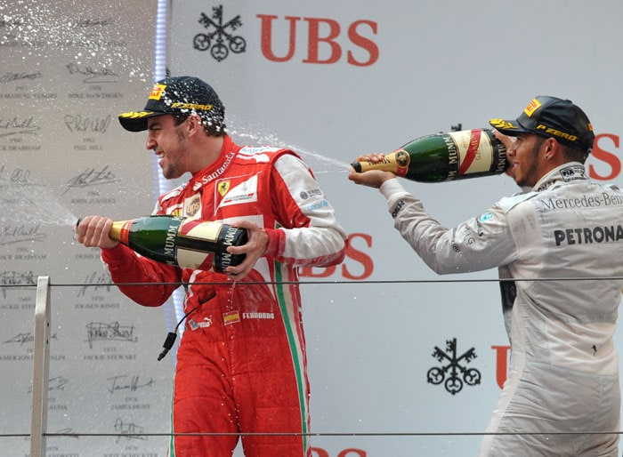 """""""It feels good, it is a long time from my victory here eight years ago,"""" said the Spaniard, who narrowly lost out to Vettel for the world title last season. <br> Alonso said that he was delighted to get his season back on track after retiring early in Malaysia last month. The two-time world champion was second, behind the rejuvenated Raikkonen, in the season-opening race in Melbourne."""