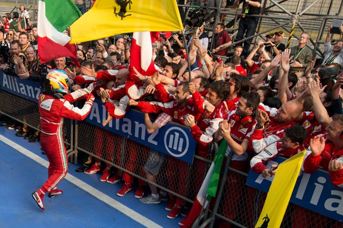 Alonso celebrates in the event of winning the Chinese Grand Prix.