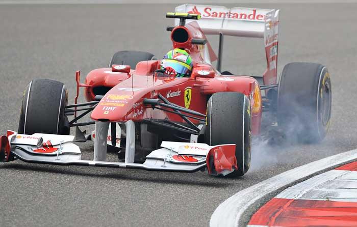 Ferrari driver Felipe Massa of Brazil locks his brakes during the second qualifying session. (AFP Photo)