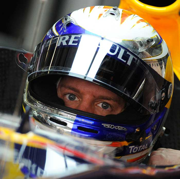 Red Bull Racing driver Sebastian Vettel of Germany gets ready in his car during the second practice session. (AFP Photo)