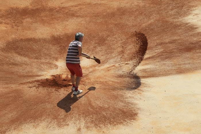 Crushed red brick is spread on the Philippe-Chatrier centre court at the Roland-Garros stadium. (AFP Photo)