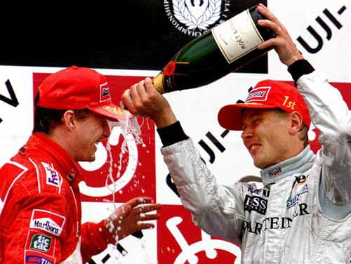 1999 (Mika Hakkinen vs Eddie Irvine)<br><br> With Michael Schumacher out of the equation with a broken leg midway through the season, it essentialy became a two-way battle between McLaren's Mika Hakkinen (right) and Ferrari's Eddie Irvine (left). Schumi was however back for the last 2 races and was the pole-sitter for the Japanese GP, the race that was to bring down the curtains on the season, the 50th for the sport.<br><br> Hakkinen took the 2nd spot while Ervine, who was leading the drivers' standings by 4 points, was back at 5th. Hakkinen overtook Schumacher at the start of the race and barring a brief exchange of positions with the German after the pit stops, the Finn maintained his lead.<br><br> Irvine had no such luck. After making his pit stop, the Ferrari driver was overtaken by Hakkinen's McLaren team-mate David Coulthard who slowed his pace and held Irvine up. Although Coulthard spun off and crashed out on the 39th lap, by then it was too late for Irvine to catch up. Hakkinen won the race and with Irvine finishing only 3rd, the Finn also won the championship by 2 points, to claim his 2nd successive title.