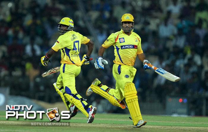 MS Dhoni and Dwayne Bravo run between the wicket during the Champions League T20 match between Cape Cobras and Chennai Super Kings in Chennai. (PTI Photo)