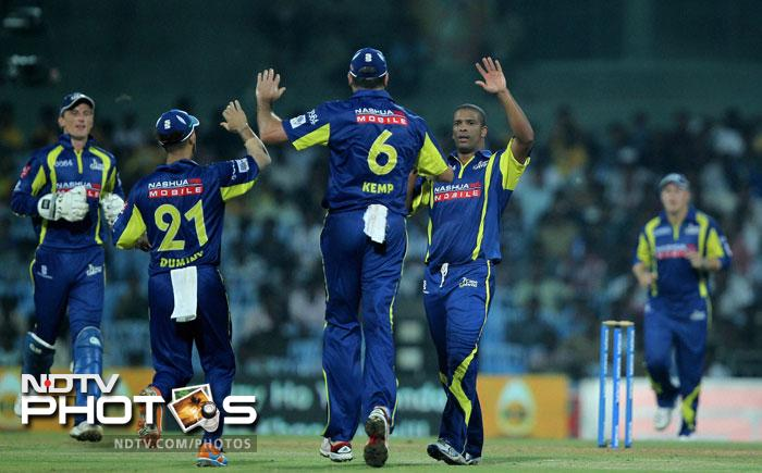 Cape Cobras cricketers celebrate the wicket of Chennai Super Kings' Murali Vijay during the Champions League T20 in Chennai. (PTI Photo)