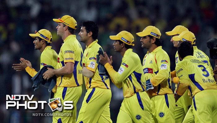 Chennai Super Kings players celebrate the wicket of Cape Cobras' Richard Levi during the Champions League T20 match in Chennai. (PTI Photo)