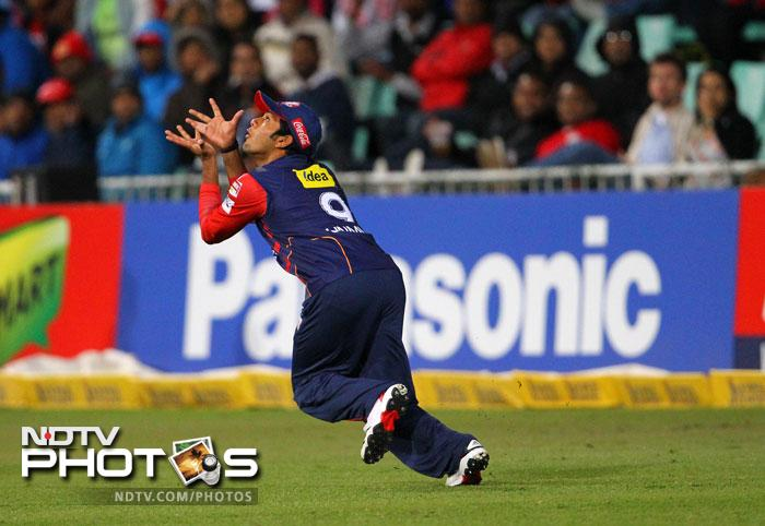 Unmukt Chand goes for a catch during the CLT20 semi-final match between the Delhi Daredevils of India and the Highveld Lions of South Africa at the Sahara Park Kingsmead in Durban. (AFP Photo)
