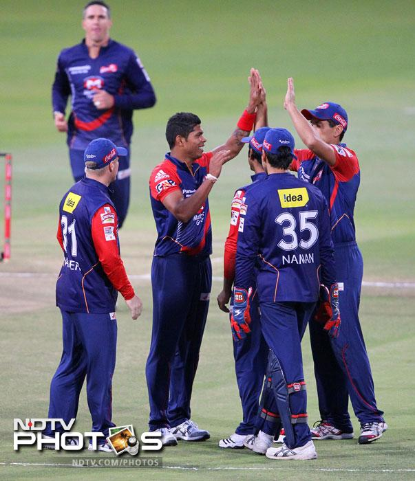 Umesh Yadav celebrates with teammates after taking the wicket of Alviro Petersen during the CLT20 match between the Delhi Daredevils of India and the Highveld Lions of South Africa at the Sahara Park Kingsmead in Durban. (AFP Photo)