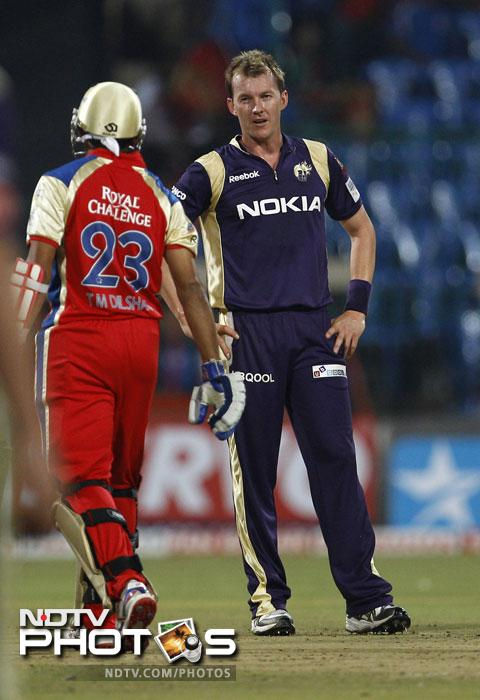 Brett Lee looks at Tillakaratne Dilshan after bowling a delivery to him during their Champions League Twenty20 match in Bangalore. (AP Photo)