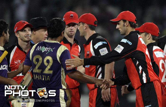 South Australian Redbacks players and Kolkata Knight Riders players congratulate each other at the end of their match during the Champions League Twenty20 match in Hyderabad. (AP Photo)