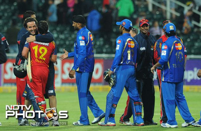 Mumbai Indians bowler Harbhajan Singh goes to congratulate the Highveld Lions after losing to them in the Group B Match of the Champions League T20 (CLT20) at the Wanderers Stadium in Johannesburg. (AFP Photo)