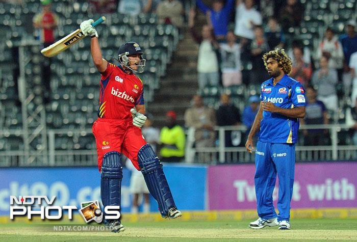 Highveld Lions batsman Neil McKenzie celebrates beating Mumbai Indians in the Group B Match of the Champions League T20 (CLT20) at the Wanderers Stadium in Johannesburg. (AFP Photo)