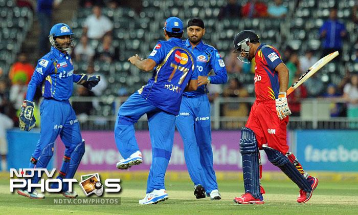 Mumbai Indians bowler Harbhajan Singh celebrates the wicket of Highveld Lions Gulam Bodi on during Group B Match of the Champions League T20 (CLT20) at the Wanderers Stadium in Johannesburg. (AFP Photo)