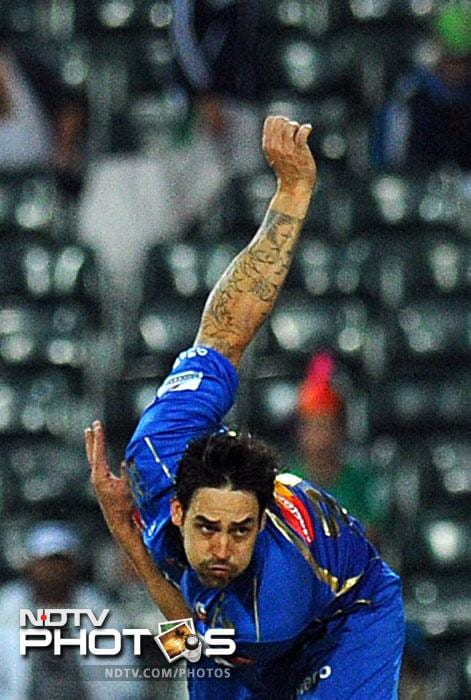 Mumbai Indians Mitchell Johnson bowls against Highveld Lions' Alviro Petersen during Group B Match of the Champions League T20 (CLT20) at the Wanderers Stadium in Johannesburg. (AFP Photo)