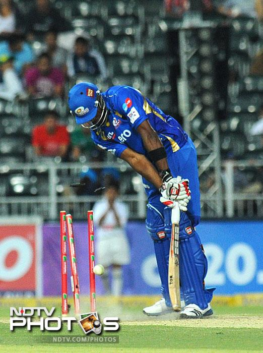 Mumbai Indians' Rohit Sharma is bowled out during Group B Match of the Champions League T20 (CLT20) at the Wanderers Stadium in Johannesburg. (AFP Photo)