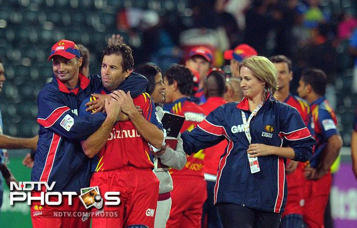Highveld Lions captain Alviro Petersen and batsman Quinton de Kock celebrate after beating Mumbai Indians in the Group B Match of the Champions League T20 (CLT20) at the Wanderers Stadium in Johannesburg. (AFP Photo)
