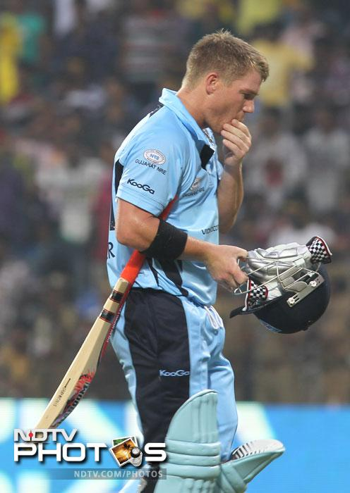 David Warner walks off the field after being caught out by Harbhajan Singh during the Champions League T20 match between Mumbai Indians and New South Wales Blues at the M.A. Chidambaram Stadium in Chennai. (AFP Photo)