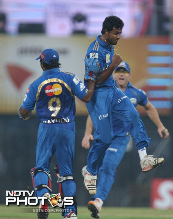Ambati Rayudu and Abu Nechim Ahmed celebrate the dismissal of Shane Watson during the Champions League T20 match between Mumbai Indians and New South Wales Blues at the M.A. Chidambaram Stadium in Chennai. (AFP Photo)