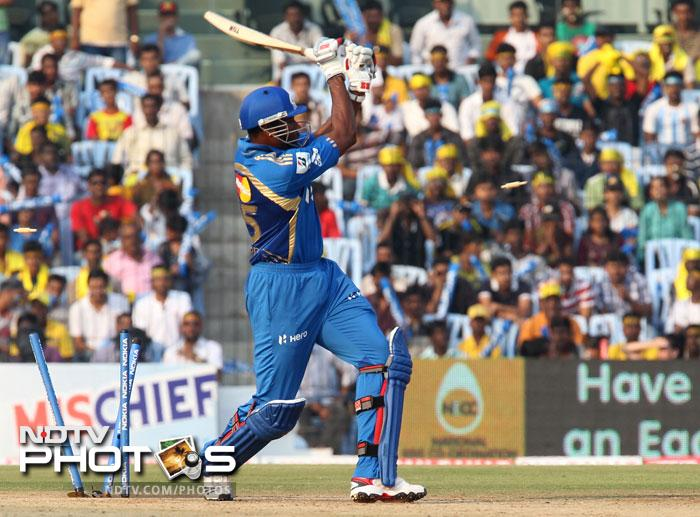 Kieron Pollard is clean bowled by Patrick Cummins during the Champions League T20 match between Mumbai Indians and New South Wales Blues at the M.A. Chidambaram Stadium in Chennai. (AFP Photo)