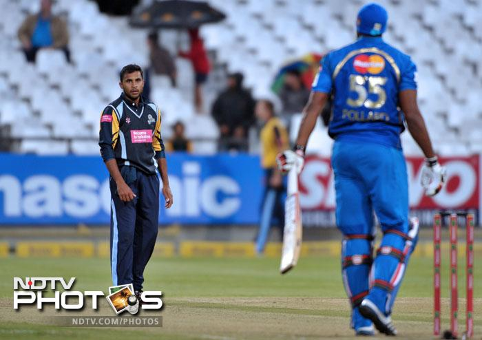 Adil Rashid of Yorkshire Carnegie stares down Kieron Pollard of the Mumbai Indians during Match 11 of the Champions League T20 between the Mumbai Indians (India) and Yorkshire (England) at Newlands Cricket Stadium in Cape Town. (AFP Photo)