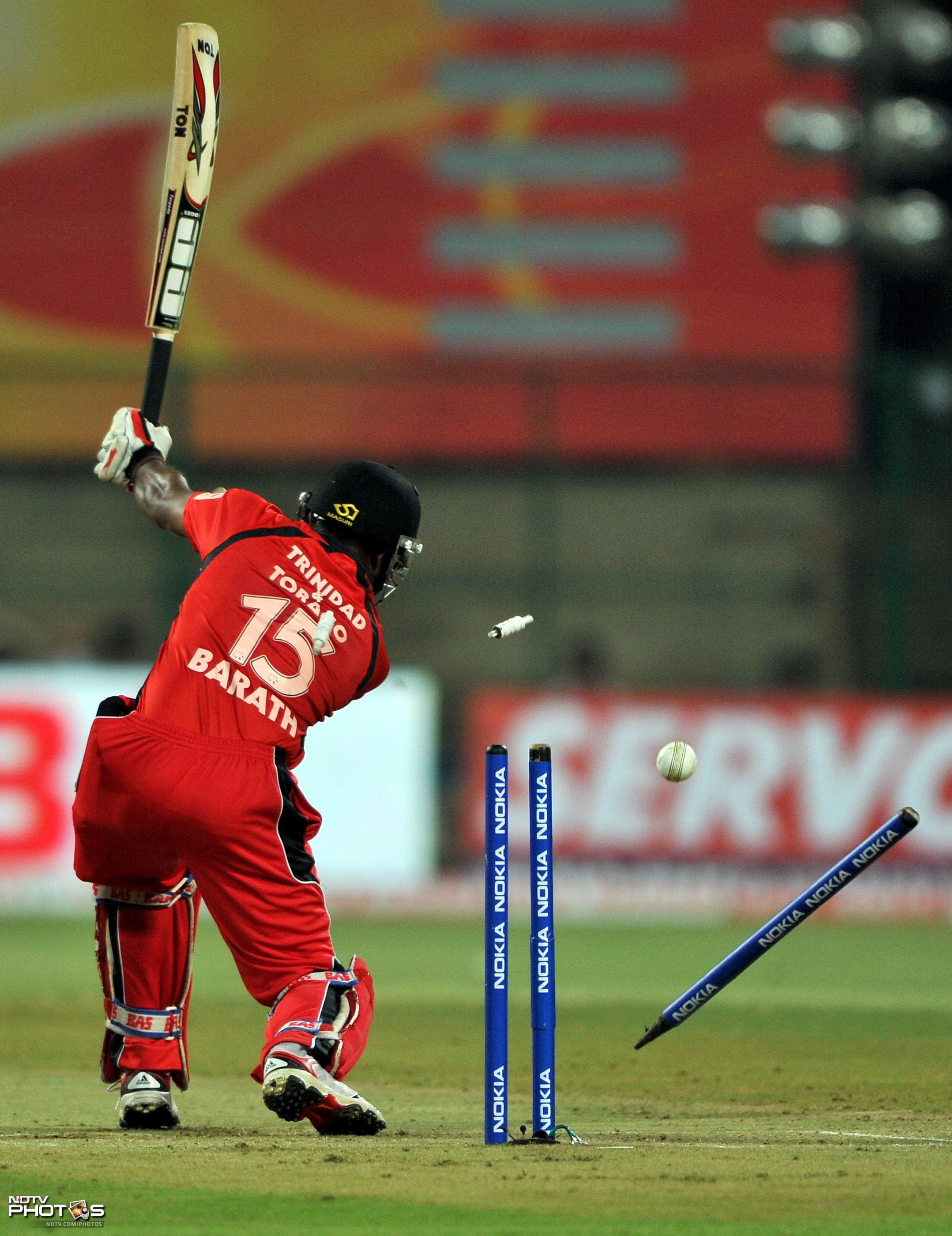 Adrian Barath is dismissed by Lasith Malinga during the Champions League Twenty20 Group A match between Mumbai Indians and Trinidad and Tobago at the M. Chinnaswamy Stadium in Bangalore. (AFP Photo)