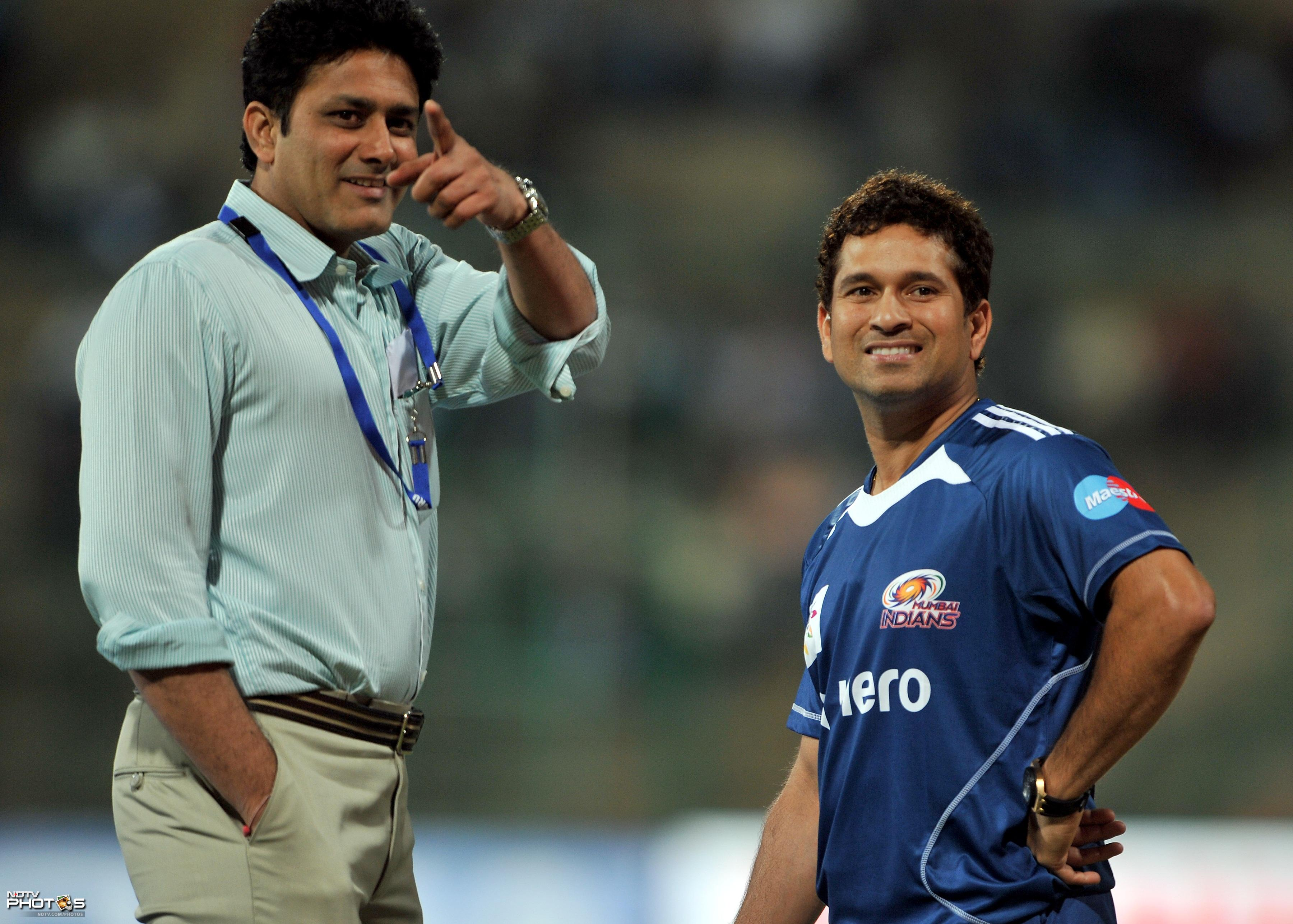 Former Indian cricketer and current Karnataka State Association (KSCA) president Anil Kumble gestures as Mumbai Indians player Sachin Tendulkar looks on before the start of the Champions League Twenty20 Group A match between Mumbai Indians and Trinidad and Tobago at the M. Chinnaswamy Stadium in Bangalore. (AFP Photo)