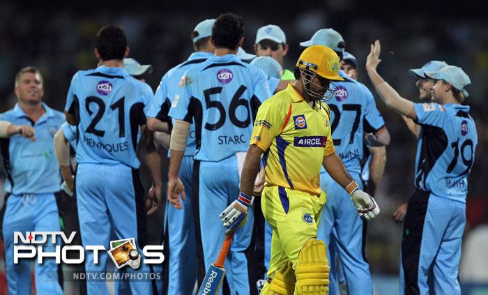 Chennai Super Kings' skipper MS Dhoni returns to pavilion after losing his wicket during the Champions league T20 match against New South Wales Blues' in Chennai. (PTI Photo)