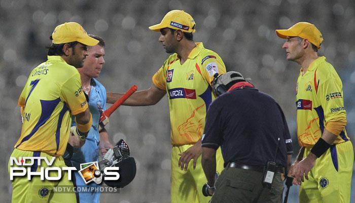 New South Wales Blues' David Warner being congratulated by MS Dhoni and his teammates during their Champions league T20 match in Chennai. (PTI Photo)