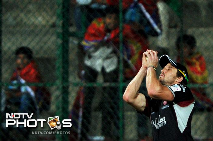 Nick Compton catches a shot by Colin Ingram on during the Champions League Twenty20 League match between Warriors and Somerset at the M. Chinnaswamy Stadium in Bangalore. (AFP Photo)