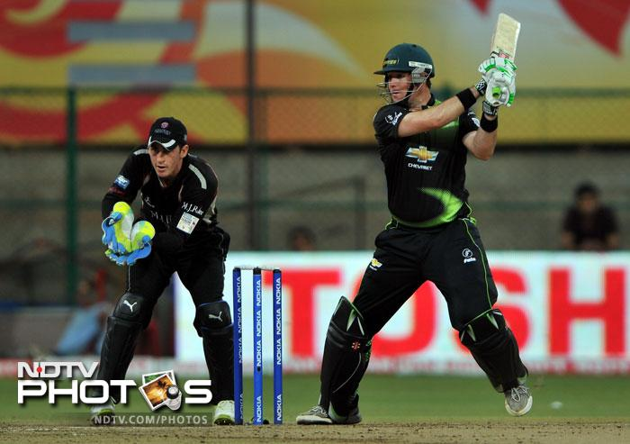 Colin Ingram plays a shot while Craig Kieswetter looks on during the Champions League Twenty20 League match between Warriors and Somerset at the M. Chinnaswamy Stadium in Bangalore. (AFP Photo)