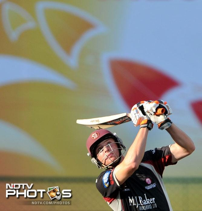 Joss Butler hits a six during the Champions League Twenty20 League match between Warriors and Somerset at the M. Chinnaswamy Stadium in Bangalore. (AFP Photo)