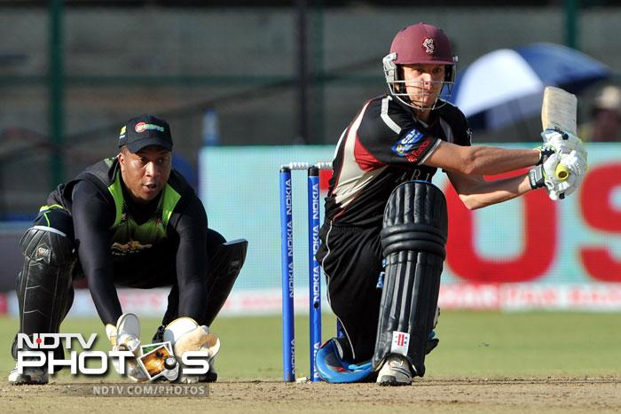 Athenkosi Dyili watches as James Hildreth plays a shot during the Champions League Twenty20 League match between Warriors and Somerset at the M. Chinnaswamy Stadium in Bangalore. (AFP Photo)