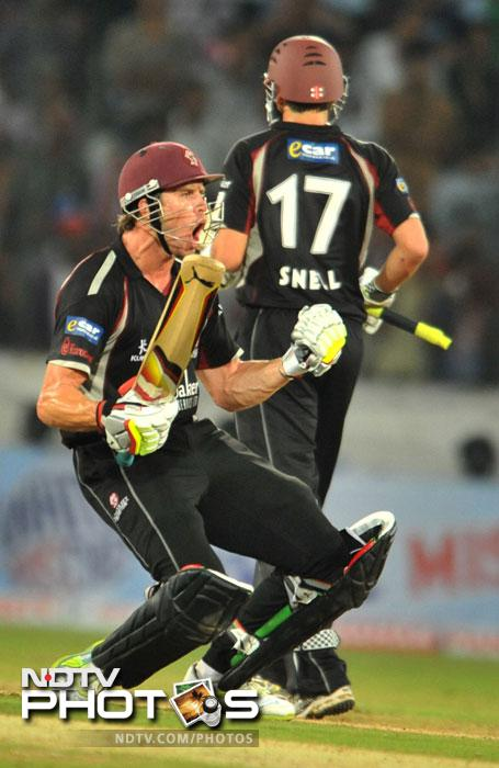 Nick Compton and Stephen Snell celebrate after winning the match during the Champions League Twenty20 Group B match between Kolkata Knight Riders and Somerset at the Rajiv Gandhi International Stadium in Hyderabad. Somerset won the match by 5 wickets. (AFP Photo)