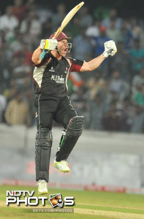 Somerset batsmen Nick Compton jumps as he celebrates victory during the Champions League Twenty20 Group B match between Kolkata Knight Riders and Somerset at the Rajiv Gandhi International Stadium in Hyderabad. (AFP Photo)