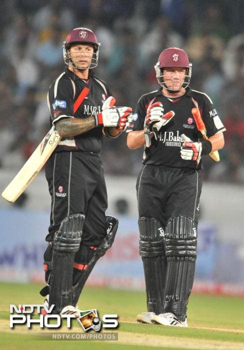 Peter Trego and Roelof van der Merwe gesture during the Champions League Twenty20 Group B match between Kolkata Knight Riders and Somerset at the Rajiv Gandhi International Stadium in Hyderabad. (AFP Photo)