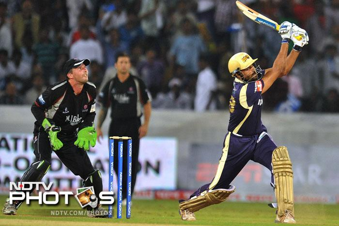 Stephen Snell watches as Yusuf Pathan plays a shot during the Champions League Twenty20 Group B match between Kolkata Knight Riders and Somerset at the Rajiv Gandhi International Stadium in Hyderabad. (AFP Photo)