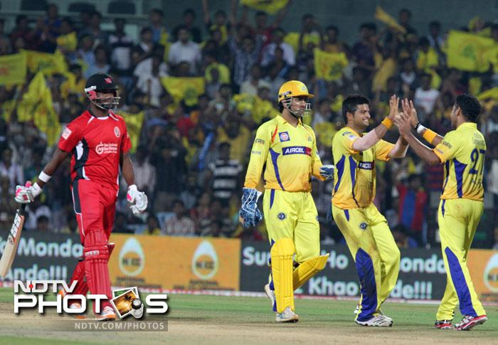 Suresh Raina, Shadab Jakati and MS Dhoni celebrate dismissing Darren Bravo during the Champions League T20 match between Chennai Super Kings and Trinidad & Tobago at the M.A Chidambaram Stadium in Chennai. (AFP Photo)