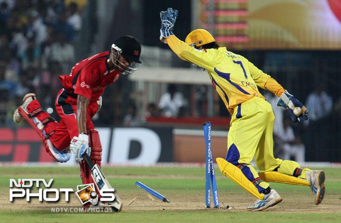 Lendl Simmons is run out by MS Dhoni during the Champions League T20 match between Chennai Super Kings and Trinidad & Tobago at the M.A Chidambaram Stadium in Chennai. (AFP Photo)