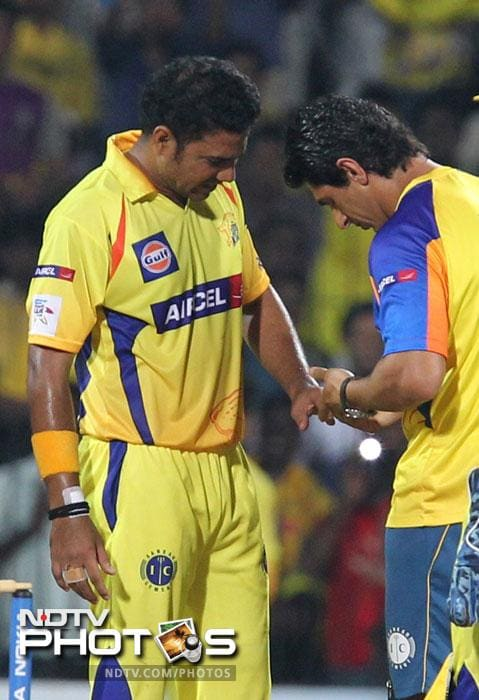Shadab Jakati is treated for an injury to his finger during the Champions League T20 match between Chennai Super Kings and Trinidad & Tobago at the M.A Chidambaram Stadium in Chennai. (AFP Photo)