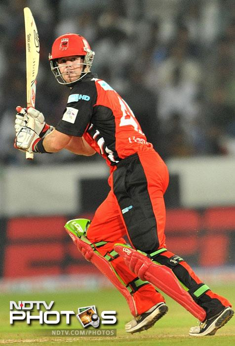 Daniel Christian looks back after playing a shot during the Champions League Twenty20 Group B match between the Warriors and South Australia Redbacks at the Rajiv Gandhi International Stadium in Hyderabad. (AFP Photo)