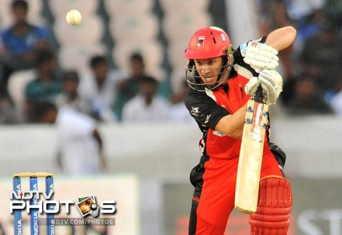 Michael Klinger plays a shot during the Champions League Twenty20 Group B match between the Warriors and South Australia Redbacks at the Rajiv Gandhi International Stadium in Hyderabad. (AFP Photo)