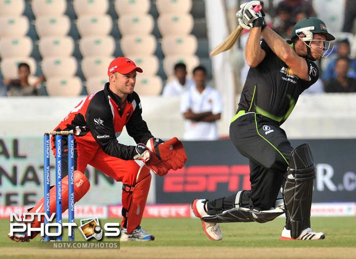 Colin Ingram plays a shot as Timothy Paul Ludeman watches during the Champions League Twenty20 Group B match between the Warriors and South Australia Redbacks at the Rajiv Gandhi International Stadium in Hyderabad. (AFP Photo)