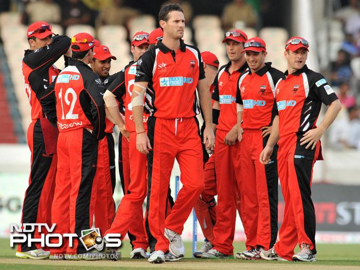 Shaun Tait celebrates with teammates after dismissing Ashwell Prince during the Champions League Twenty20 Group B match between the Warriors and South Australia Redbacks at the Rajiv Gandhi International Stadium in Hyderabad. (AFP Photo)