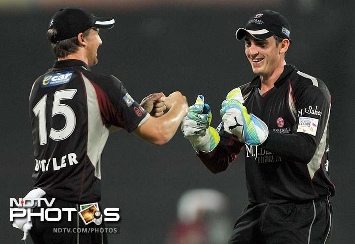 Somerset found the occasional success. Wicket keeper Craig Kieswetter (R) congratulates teammate Jos Butler after a dismissal.