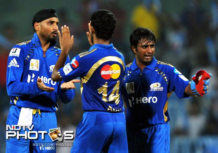 Mumbai Indians had a brash day with the bat and a focused bowling attack, all together. They scripted a 10-run win however, to cruise into the final of CLT20. (AP and AFP images)