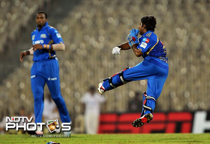 The fielding was also top-notch. Mumbai Indians wicket keeper Ambati Rayudu (right) throws a ball back in this photo while his team mate Kieron Pollard watches.